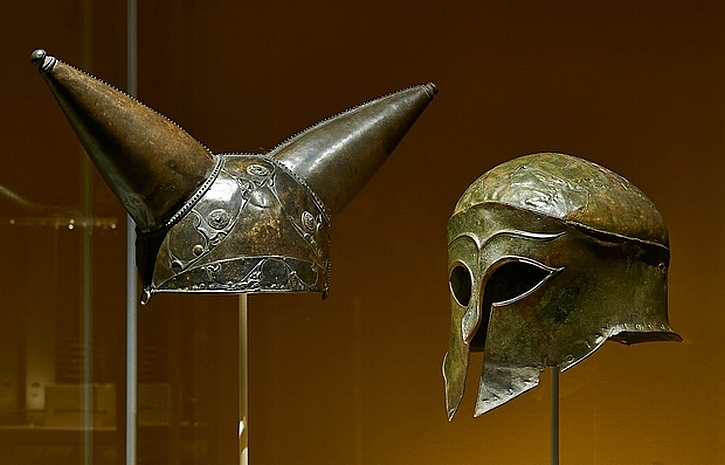 A horned helmet from the Thames, 200-50 BC alongside a bronze Greek helmet, south-western Greece, around 460 BC