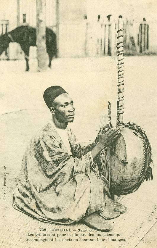 A French postcard showing a griot (musician and story-teller), c. 1904