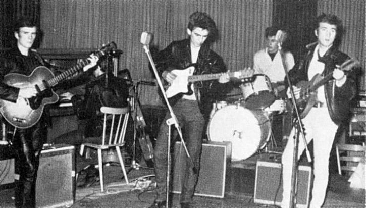 Beatles on stage in Hamburg. Paul at the piano, Stuart on bass, Pete Best on drumsPete