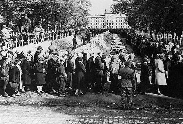 German civilians are forced to watch as the murdered victims of Woebbelin concentration camp are buried in Ludwigslust on, 7 May 1945.