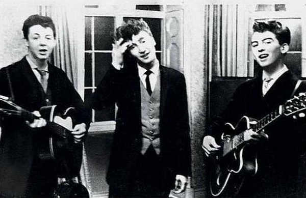 John, Paul and George, at the time known as Japage 3 on 20 December 1958 at the Childwall Abbey Hotel on Childwall Abbey Road. Paul's brother Mike made up the foursome.