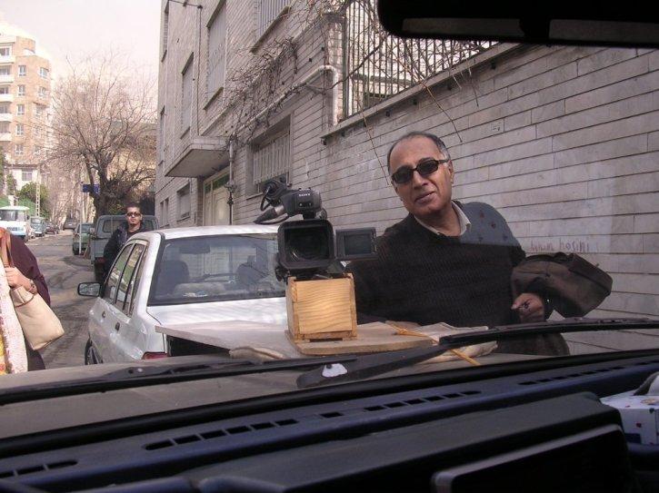 Abbas Kiarostami showing his camera bonnet mount - a wine box - for Mark Cousins