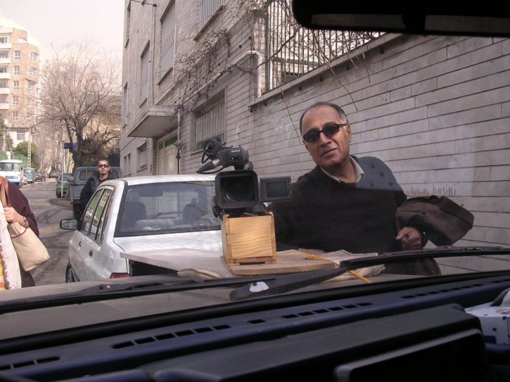 Abbas Kiarostami showing his camera bonnet mount - a wine box - for Mark Cousins