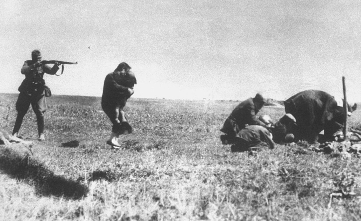 A Nazi soldier murdering Jewish civilians, including a mother and child, in 1942, at Ivanhorod, Ukraine.