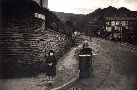 A girl stands at the end of Moy Road in Aberfan, where the schoolhouse stood before it was engulfed by the coal tip