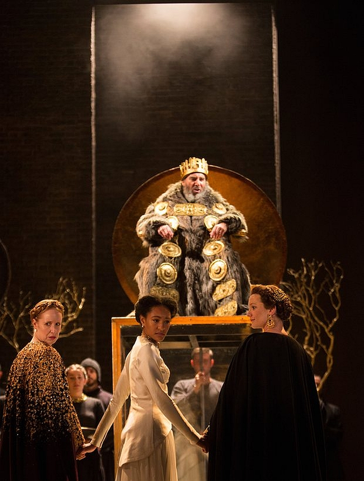 Goneril (Nia Gwynne), Natalie Simpson (Cordelia) and Kelly Williams (Regan) stand before Antony Sher as King Lear makes his dramatic entrance