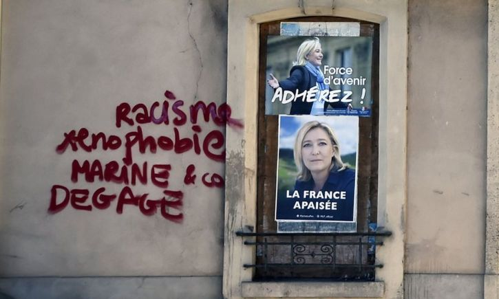 Anti-racist graffiti on the wall of a Front National office