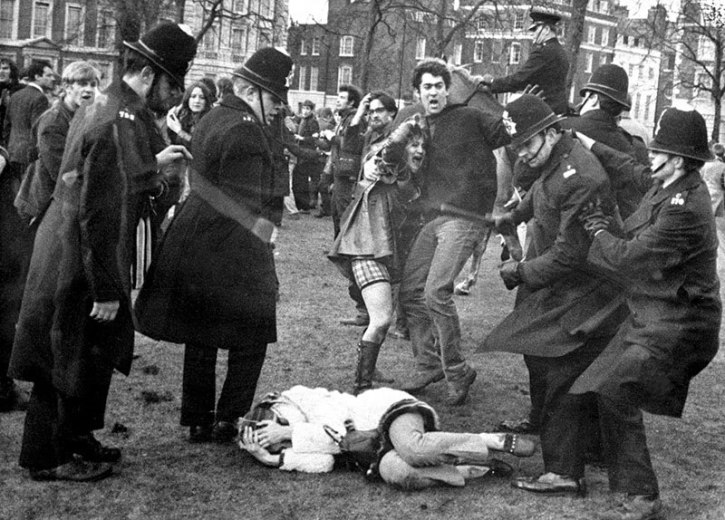 Police struggle with anti-Vietnam War demonstrators outside the American Embassy in Grosvenor Square, 17 March 1968