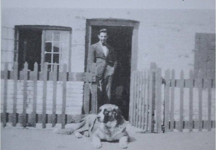 Paul Nash outside Rose Cottage, Dymchurch, 1920s