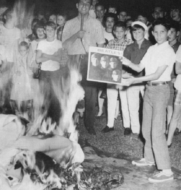 At a bonfire organised by a Birmingham radio station, Beatles records are burned