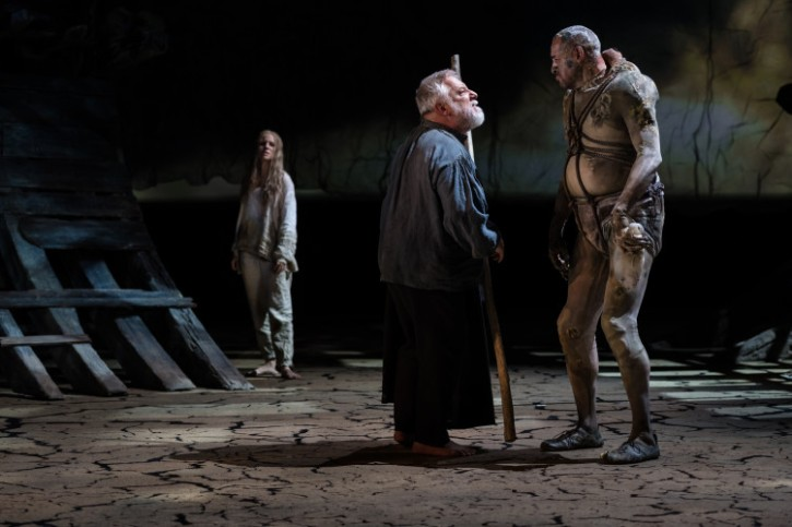 Joe Dixon as Caliban with Miranda and Prospero