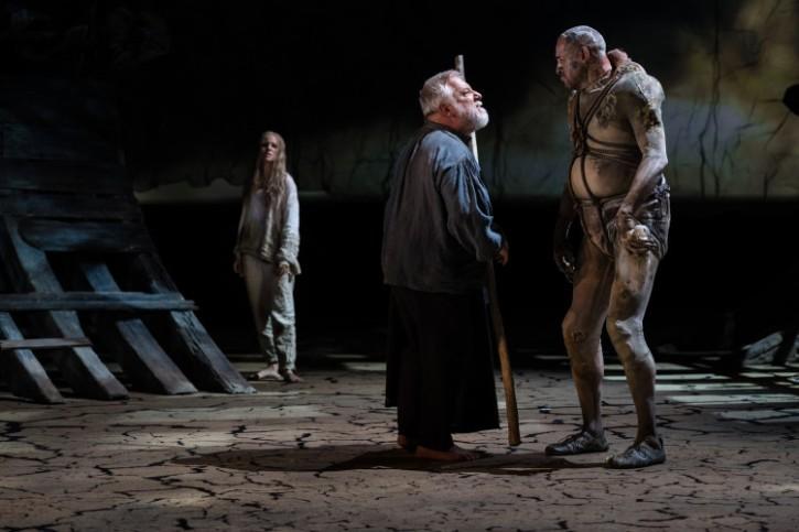 Joe Dixon as Caliban with Miranda and Prospero