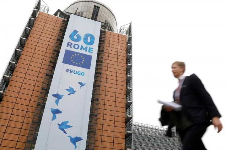 A banner celebrating 60 years since signing the Treaty of Rome outside the European Commission in Brussels