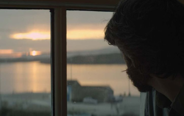 Eoghan Mac Giolla Bhríde at window in Silence